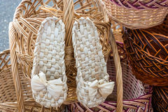 Wicker baskets and sneakers. Stock Photo