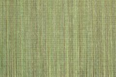 Wicker bast beach mat background. Texture of green beach mat made of bast fibers. The surface of the coarse canvas of natural plant fibers. Top view royalty free stock photos