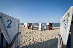 Wicker beach chair at Baltic sea Stock Photos