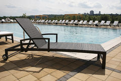 Wicker beach lounge chair Stock Photo