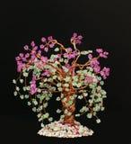 Wicker in beads.blooming sakura. Handiwork in beads.blooming sakura on black Stock Photo