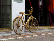 Wicker Bike Next To Shop Stock Image