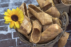 Wicker birch bark bast shoes in a basket. At the fair Stock Photo