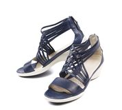 Wicker black leather sandals. Royalty Free Stock Photography