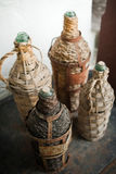 Wicker Bottle Carriers. At Kitron Factory - Naxos, Greece stock photos