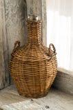 Wicker bottle Stock Images