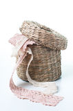 Wicker box with lace ribbons Stock Photo