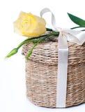 Wicker box with satin ribbon Stock Photo