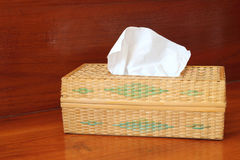 Wicker box of toilet paper Stock Images