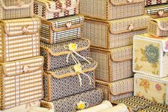 Wicker boxes with colored ornaments. In different sizes Royalty Free Stock Images