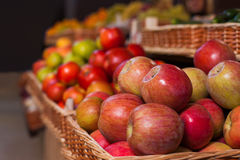 Wicker boxes with ripe apples. Stock Photos