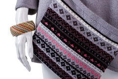Wicker bracelet and knitted handbag. Royalty Free Stock Photography