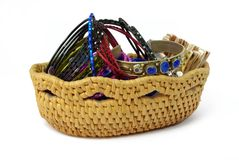 Wicker case with beads and bracelets. Wicker case with jewelry beads and bracelets Stock Images