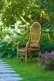 Wicker chair. In the garden Stock Photos