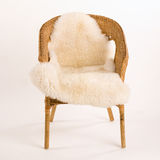 Wicker chair. Isolated wicker chair with sheep fell Royalty Free Stock Images