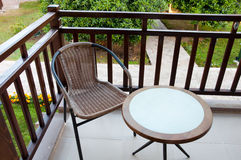 Wicker chair on balcony Royalty Free Stock Photos