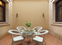 Wicker chair on the balcony of the villa stock photo