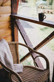 Wicker chair on a cosy balcony Stock Images