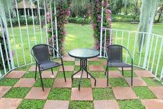 Wicker chair in the garden Stock Image