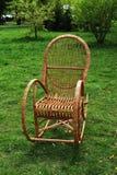Wicker chair, grass. Wicker chair rocking on a green meadow Stock Photos