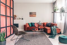 Free Wicker Chair, Gray Rug And Red Corner Couch In Colorful Living Room Interior With Green Accents Royalty Free Stock Image - 167309416