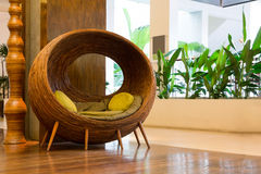 Wicker chair. Rattan Sphere Wicker chair in Lobby stock photography