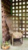 Wicker chair retro deccorate in house cornor. Wicker chair retro decorate in house corner royalty free stock image