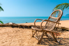 Wicker chair on the sandy beach Stock Photography