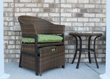 A wicker chair and table set Stock Photos