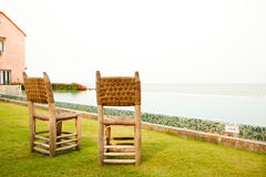 Wicker Chair in terrace Stock Photo