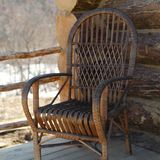 Wicker chair on veranda. A wicker chair on veranda of a wooden house, nice spring day outdoor shot royalty free stock photos