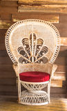 Wicker chair on wood wall background. Stock Photos
