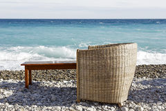 Wicker chair and wooden table Royalty Free Stock Images