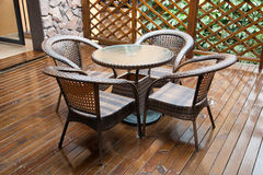 Free Wicker Chairs And Table On Deck Royalty Free Stock Images - 21966829