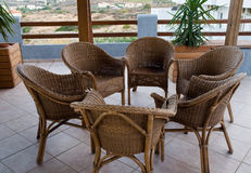 Wicker chairs on the balcony. Still life shot of a wicker chair royalty free stock images