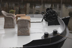 Wicker chairs on deck of historic flatboat Stock Images