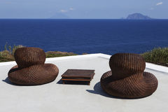 Wicker chairs on seaside terrace Stock Photography