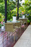 Wicker chairs and table in the garden royalty free stock images