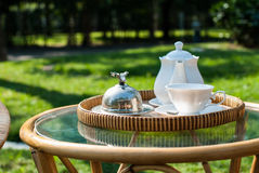 Wicker chairs and table with tea set Royalty Free Stock Photo