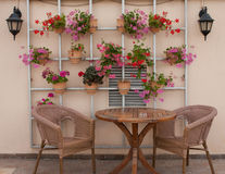 Wicker chairs and a table on the terrace Royalty Free Stock Photos