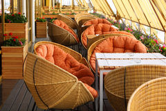 Wicker chairs and tables in restaurant Royalty Free Stock Images