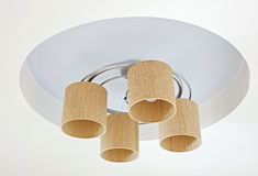 Wicker Chandelier shades. Four Wicker Chandelier shades on ceiling Stock Photos