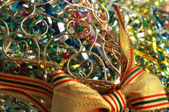 Wicker Christmas ornament with beads. And a multi-coloured tinsel and a bow Royalty Free Stock Photos