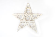 Wicker Christmas star on a white background Stock Photos