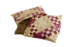 Wicker cushions. Art, woven pillows on a white background Royalty Free Stock Image