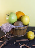 Wicker decorative cart with fruits royalty free stock photography