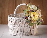 Wicker Designer Basket decorated with flower Stock Photography