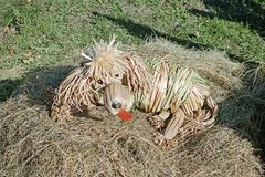 Wicker dog in the hay royalty free stock image
