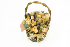 Wicker with dried flowers. Isolated Royalty Free Stock Image