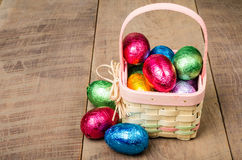 Wicker Easter basket with foil chocolate eggs Royalty Free Stock Image